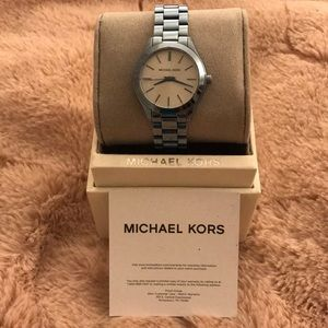 Michael Kora light blue watch